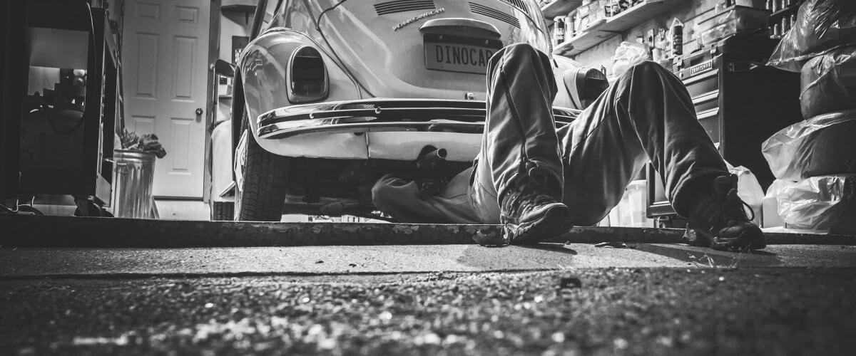 Guy fixing a car